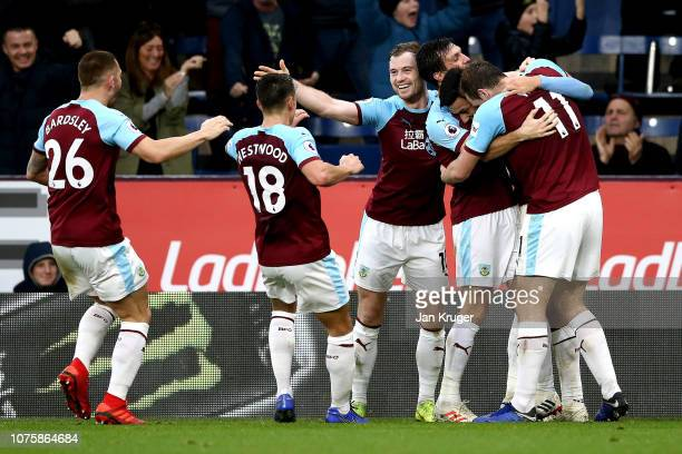 Dwight McNeil of Burnley celebrates after scoring his team's second goal with his team mates during the Premier League match between Burnley FC and...