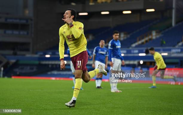 Dwight McNeil of Burnley celebrates after scoring their team's second goal during the Premier League match between Everton and Burnley at Goodison...