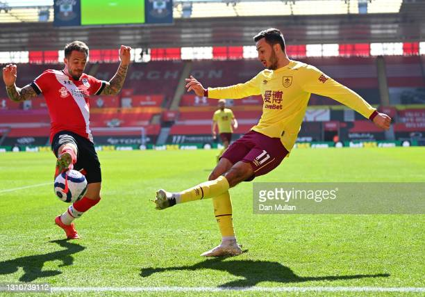 Dwight McNeil of Burnley is put under pressure by Danny Ings of Southampton during the Premier League match between Southampton and Burnley at St...
