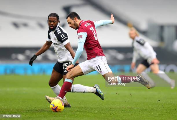 Dwight McNeil of Burnley looks to break past Josh Onomah of Fulham during The Emirates FA Cup Fourth Round match between Fulham and Burnley at Craven...
