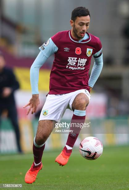 Dwight McNeil of Burnley runs with the ball during the Premier League match between Burnley and Chelsea at Turf Moor on October 31 2020 in Burnley...