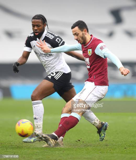 Dwight McNeil of Burnley spreads the play in front of Josh Onomah of Fulham during The Emirates FA Cup Fourth Round match between Fulham and Burnley...