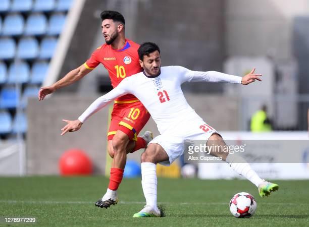 Dwight McNeil of England and Jordi Alaez of Andorra clash during the UEFA Euro U21 Qualifier between Andorra U21 and England U21 at Estadi Nacional...