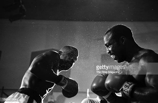 Dwight Muhammad Qawi looks to throw a punch to James Scott during the fight at the Rahway State Prison on September 5, 1981 in Woodbridge Township,...