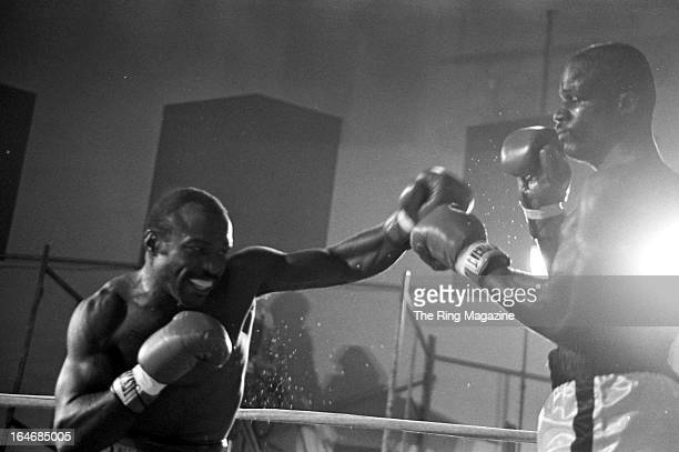 Dwight Muhammad Qawi throws a punch against James Scott during the fight at the Rahway State Prison in Woodbridge Township, New Jersey. Dwight...