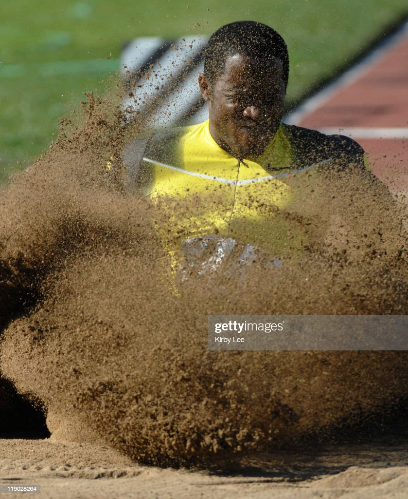 Dwight Phillips lands in the sand pit in the long jump in the 66th Coca Cola Modesto Relays at Modesto Junior College in Modesto,California on Saturday, May 6, 2007. Phillips, the 2004 Athens Olympic gold medallist, won in wind-aided 27-2 (8.28m).