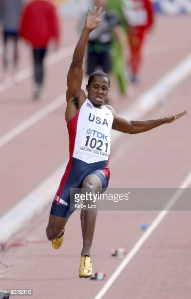 Dwight Phillips of the United States had the top qualifying mark in the long jump preliminaries with a windaided 282 1/4 in the IAAF World...