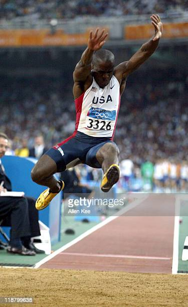 Dwight Phillips of the United States in the men's long jump final at Olympic Stadium at the Athens 2004 Olympic Games in Athens Greece on August 26...