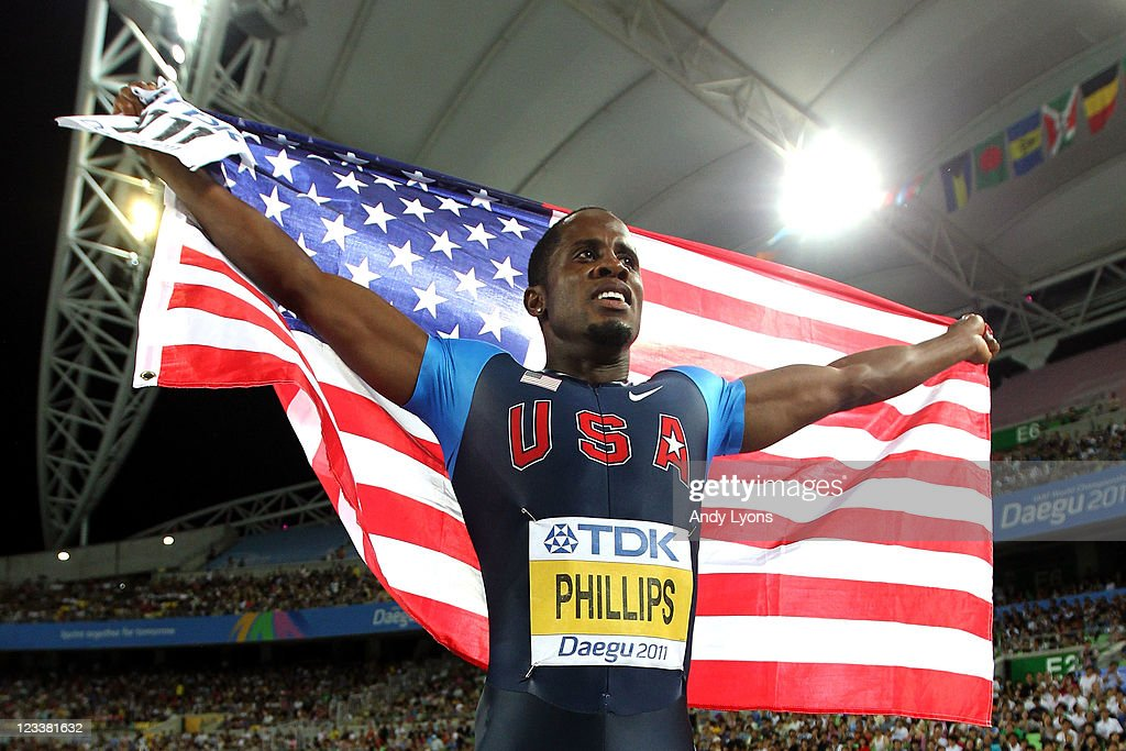 Dwight Phillips of the USA celebrates his victory in the men's long jump final during day seven of 13th IAAF World Athletics Championships at Daegu Stadium on September 2, 2011 in Daegu, South Korea.