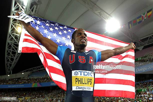 Dwight Phillips of the USA celebrates his victory in the men's long jump final during day seven of 13th IAAF World Athletics Championships at Daegu...