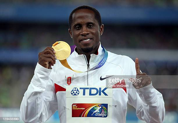 Dwight Phillips of the USA celebrates with his gold medal during the medal ceremony for the men's long jump during day eight of 13th IAAF World...