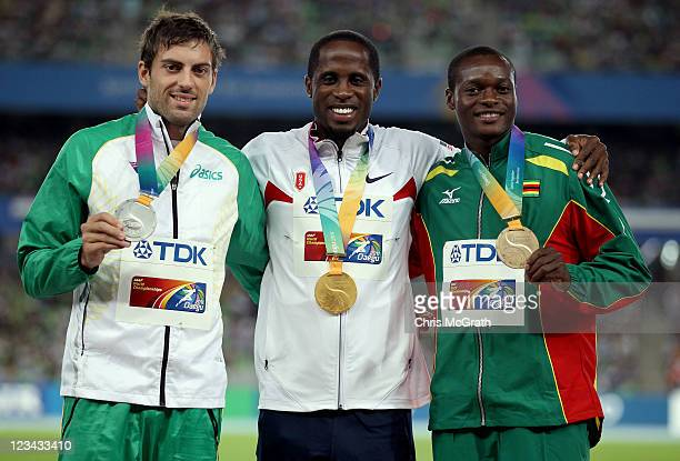 Dwight Phillips of the USA poses with his gold medal Mitchell Watt of Australia the silver and Ngonidzashe Makusha of Zimbabwe the bronze during the...