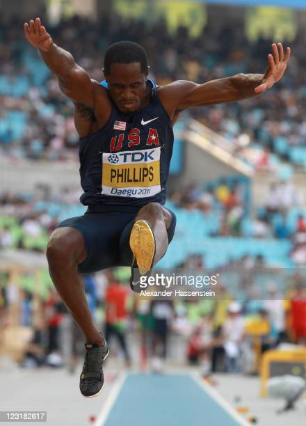 Dwight Phillips of United States competes in the men's long jump qualification round during day six of the 13th IAAF World Athletics Championships at...
