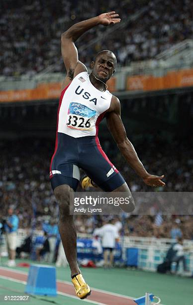 Dwight Phillips of USA competes in the men's long jump final on August 26 2004 during the Athens 2004 Summer Olympic Games at the Olympic Olympic...