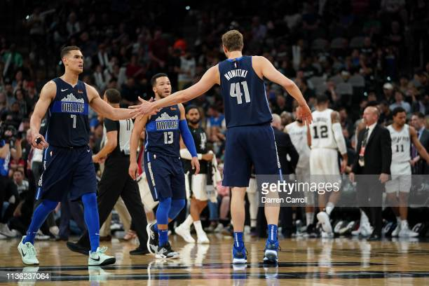 Dwight Powell and Dirk Nowitzki of the Dallas Mavericks hifive each other during the game against the San Antonio Spurs on April 10 2019 at the ATT...