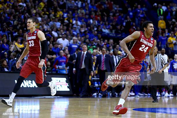Dwight Powell and Josh Huestis of the Stanford Cardinal celebrates defeating the Kansas Jayhawks 60 to 57 during the third round of the 2014 NCAA...