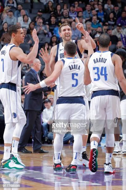 Dwight Powell Dirk Nowitzki JJ Barea and Devin Harris of the Dallas Mavericks face the Sacramento Kings on February 3 2018 at Golden 1 Center in...