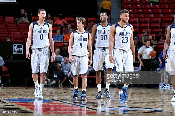Dwight Powell Kevin Pangos Jeremy Tyler and Justin Anderson of the Dallas Mavericks stand on the court during a game against the Washington Wizards...