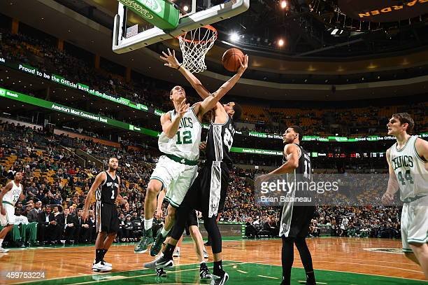 Dwight Powell of the Boston Celtics shoots the ball against the San Antonio Spurs during the game on November 30 2014 at the TD Garden in Boston...