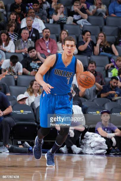 Dwight Powell of the Dallas Mavericks brings the ball up the court against the Sacramento Kings on April 4 2017 at Golden 1 Center in Sacramento...