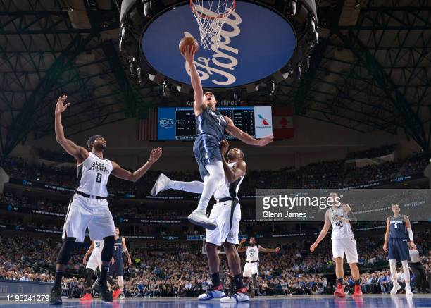 Dwight Powell of the Dallas Mavericks drives to the basket against the LA Clippers on January 21 2020 at the American Airlines Center in Dallas Texas...