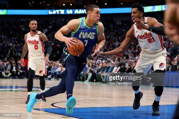 Dwight Powell of the Dallas Mavericks drives to the basket against Hassan Whiteside of the Portland Trail Blazers in the first quarter at American...