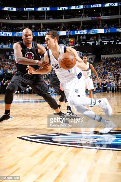 Dwight Powell of the Dallas Mavericks drives to the basket during the game against the Los Angeles Clippers on March 23 2017 at the American Airlines...