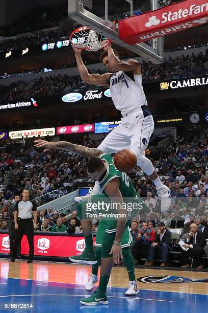 Dwight Powell of the Dallas Mavericks dunks against Daniel Theis of the Boston Celtics in the first half at American Airlines Center on November 20...