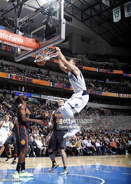 Dwight Powell of the Dallas Mavericks dunks against the Atlanta Hawks on January 7 2017 at the American Airlines Center in Dallas Texas NOTE TO USER...