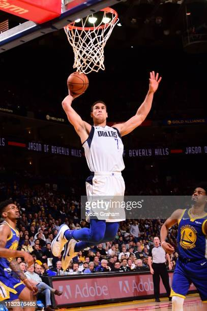 Dwight Powell of the Dallas Mavericks dunks against the Golden State Warriors on March 23 2019 at ORACLE Arena in Oakland California NOTE TO USER...