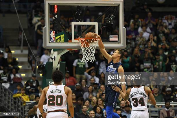 Dwight Powell of the Dallas Mavericks dunks against the Milwaukee Bucks during a game at the Bradley Center on December 8 2017 in Milwaukee Wisconsin...
