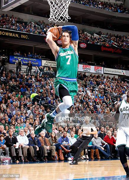 Dwight Powell of the Dallas Mavericks dunks against the Milwaukee Bucks on December 28 2015 at the American Airlines Center in Dallas Texas NOTE TO...