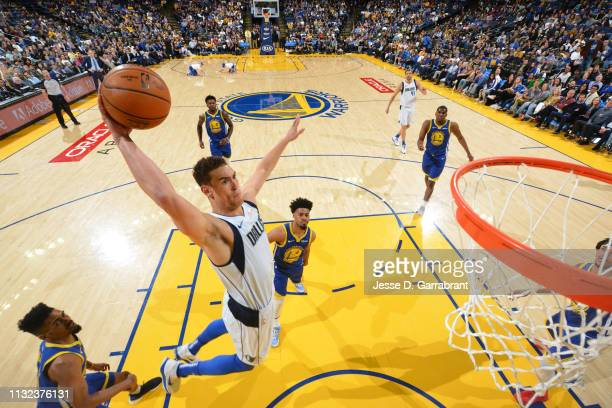 Dwight Powell of the Dallas Mavericks dunks the ball against the Golden State Warriors on March 22 2019 at ORACLE Arena in Oakland California NOTE TO...