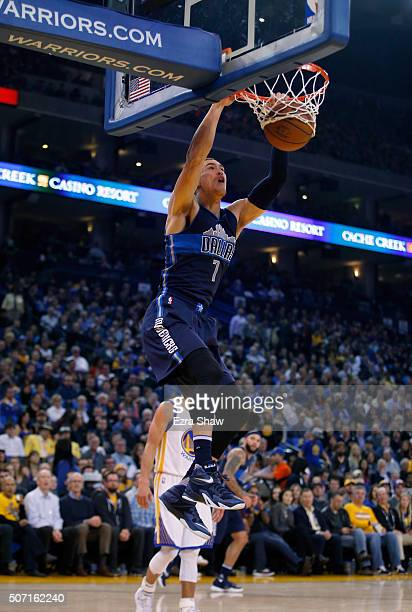 Dwight Powell of the Dallas Mavericks dunks the ball against the Golden State Warriors at ORACLE Arena on January 27 2016 in Oakland California NOTE...