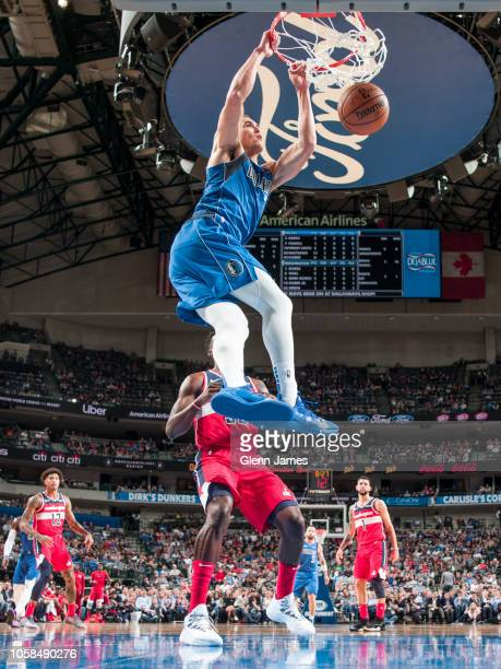 Dwight Powell of the Dallas Mavericks dunks the ball during the game against the Washington Wizards on October 6 2018 at the American Airlines Center...