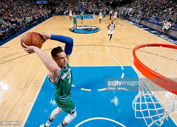 Dwight Powell of the Dallas Mavericks goes in for the dunk against the Milwaukee Bucks on December 28 2015 at the American Airlines Center in Dallas...