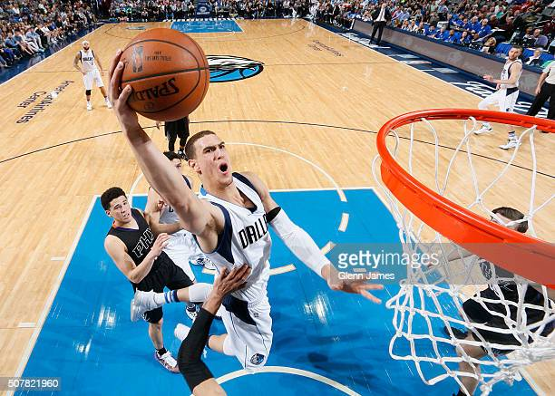 Dwight Powell of the Dallas Mavericks goes in for the layup against the Phoenix Suns on January 31 2016 at the American Airlines Center in Dallas...