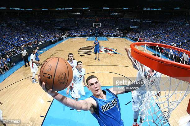 Dwight Powell of the Dallas Mavericks goes to the basket against the Oklahoma City Thunder in Game Five of the Western Conference Quarterfinals...