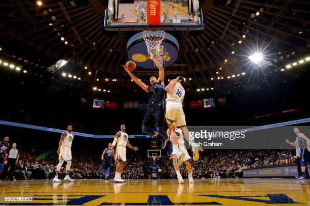 Dwight Powell of the Dallas Mavericks goes to the basket against the Golden State Warriors on December 14 2017 at ORACLE Arena in Oakland California...