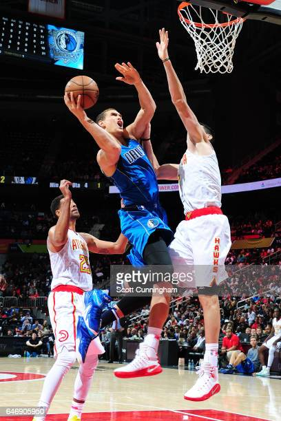 Dwight Powell of the Dallas Mavericks goes up for a lay up against the Atlanta Hawks on March 1 2017 at Philips Arena in Atlanta Georgia NOTE TO USER...