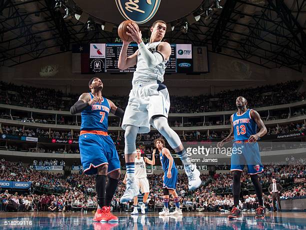Dwight Powell of the Dallas Mavericks grabs a rebound against the New York Knicks on March 30 2016 at the American Airlines Center in Dallas Texas...