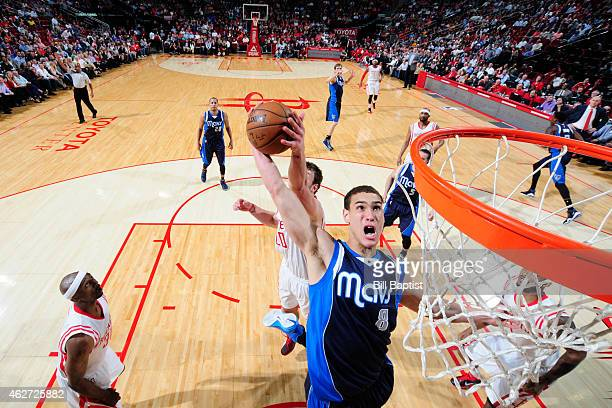 Dwight Powell of the Dallas Mavericks grabs a rebound against the Houston Rockets on January 28 2015 at the Toyota Center in Houston Texas NOTE TO...
