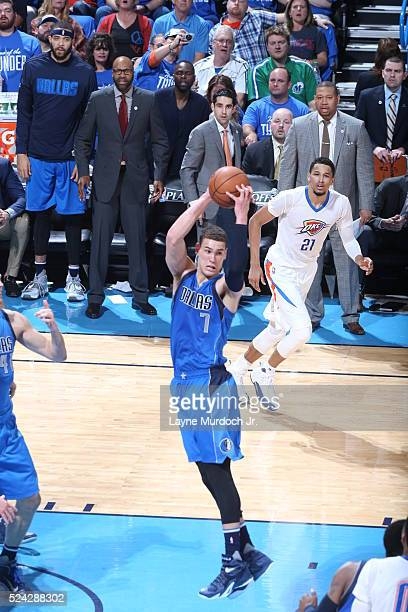 Dwight Powell of the Dallas Mavericks grabs the rebound against the Oklahoma City Thunder during Game Five of the Western Conference Quarterfinals...