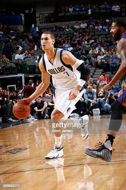 Dwight Powell of the Dallas Mavericks handles the ball against the Phoenix Suns on October 21 2015 at the American Airlines Center in Dallas Texas...