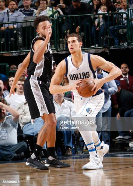 Dwight Powell of the Dallas Mavericks handles the ball against the San Antonio Spurs during the game on April 7 2017 at the American Airlines Center...