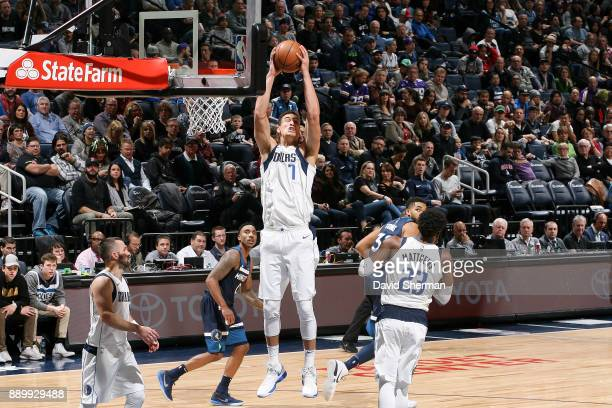 Dwight Powell of the Dallas Mavericks handles the ball against the Minnesota Timberwolves on December 10 2017 at Target Center in Minneapolis...