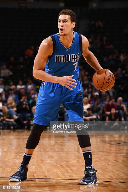 Dwight Powell of the Dallas Mavericks handles the ball during a preseason game against the Denver Nuggets on October 21 2016 at the Pepsi Center in...