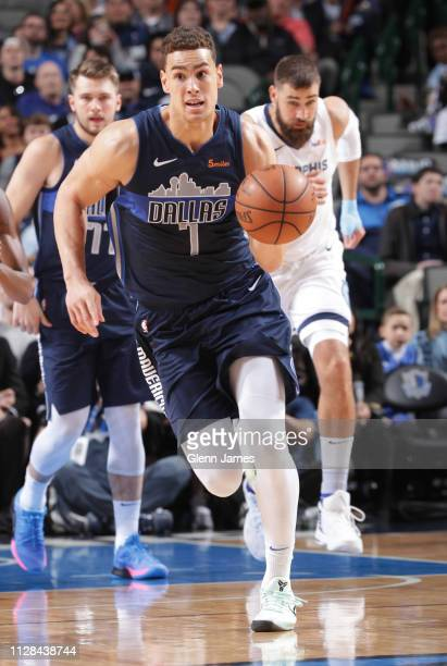Dwight Powell of the Dallas Mavericks handles the ball during the game against the Memphis Grizzlies on March 2 2019 at the American Airlines Center...