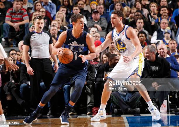 Dwight Powell of the Dallas Mavericks handles the ball during the game against the Golden State Warriors on January 3 2018 at the American Airlines...