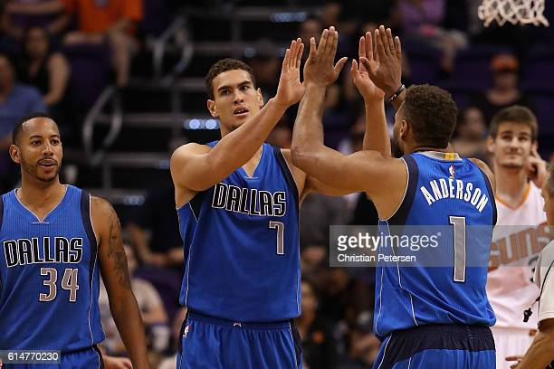 Dwight Powell of the Dallas Mavericks high fives Justin Anderson after scoring against the Phoenix Suns uring the second half of the preseason NBA...
